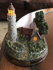 "Thomas Kinkade ""The Light Of Peace"" Lighthouse Decorative display lights up"