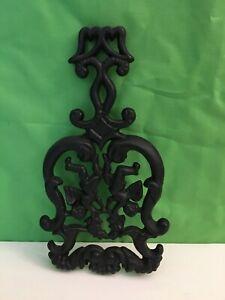 Vintage CUPIDS cast iron trivet, pot holder, excellent condition