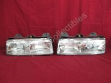 NOS OEM Pontiac Trans Sport Olds Silhouette, Lumina APV Headlight 1990 - 93 PAIR