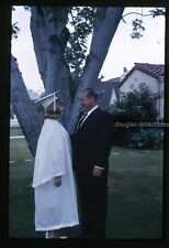 1960s  amateur 35mm Photo slideTeenage girl in graduation gown Los Angeles CA