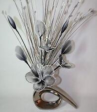 Artificial flower arrangement Black White Glitter Nylon Flowers in Silver Vase.