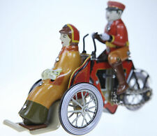 CLASSIC WIND-UP   TIN TOY MAN ON TRIKE & LADY WITH CAT .