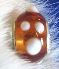 Honey Amber with White Dots Glass bead marked Calina