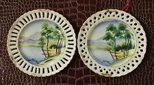 """Two 6 1/4"""" hand painted Hitomi signed decorative plates"""