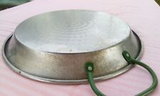 Steel paella pan with green handles