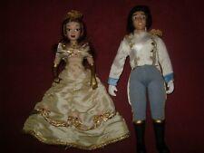 2 muñecas princesas Disney Bella y Principe de porcelana con dos hombreras