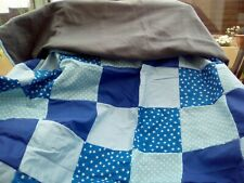 home made fleece blanket with blue patchwork