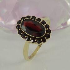Markenlose runde Ringe im Cluster-Stil aus Gelbgold mit Edelsteinen