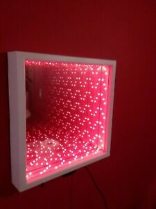 Music Infinity Mirror with color changing LEDs and 20 key wireless remote.