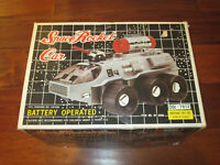 1970s NANYANG SPACE ROCKET CAR BATTERY OPERATED LASER CANNON NEW