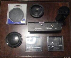 Olympus OM system Winder 2. 2 Focusing Screen. Skylight 1 B. Olympus lens case.