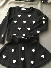 Girls Clothing/ H&M sweater and skirt. Black with hearts 4-6