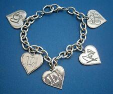 AT751*) Silver tone One Direction pop dance group autographed charm bracelet