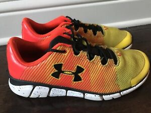 Under Armour youth boys athletic running shoes yellow/ orange 5.5 M used