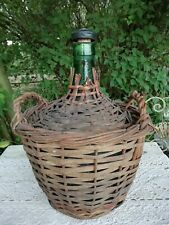 More details for vintage 5 litre spanish green glass demijohn carboy in two handle wicker basket