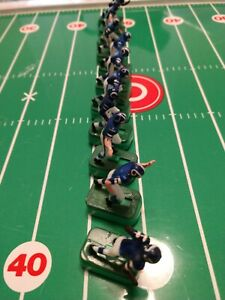 Vintage Tudor Electric Football Rams with black shoes and bases.