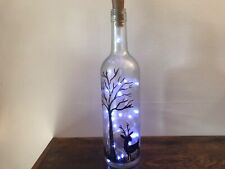 Glass bottle, frosted and hand painted, with lights.
