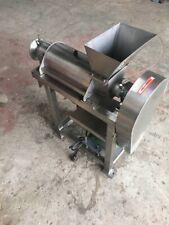 Custom industrial juicer, stainless Steel, auger, used, on legs