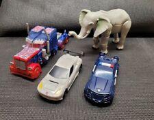 Lot of 4 Transformers~Optimus Prime~Elephant~Police Car~Race Car