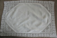 Vintage rectangular white linen cloth with crochet edges and corner inserts.