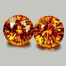 1.25 tcw Matched-Pair Natural Round-cut Orange VS1 Hessonite Garnets (Nigeria)
