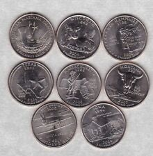 EIGHT DIFFERENT USA STATE QUARTER DOLLARS 2000 TO 2009 IN NEAR MINT CONDITION