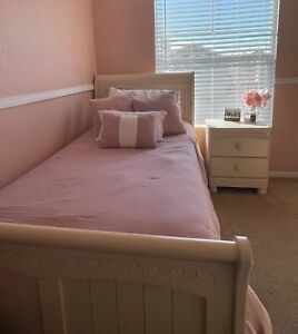 Bedroom set including twin size bed, night stand, and dresser.