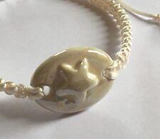 White Enamelled Ceramic Star Charm on Off White Macrame Bracelet