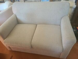 Beige Sleeper Love Seat with mattresses slightly used.  Fabric sample included.