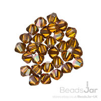 Swarovski 5328 Crystal Bicone Beads (001) Crystal Copper 4mm Pack of 30 (C30/13)