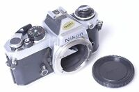 PARTS OR REPAIR*  NIKON FE SLR 35MM CAMERA IN NICE CONDITION W/CAP