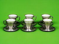 A set of six sterling silver demitasse or espresso coffee cups and saucers.