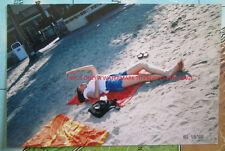 Photo of Pretty Asian Woman Laying On Back At Beach Blocking Sun w/Hand 139