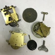 A selection of 8 day clock and other mechanical clock parts and accessories