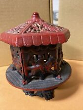 Antique Red & Black Cast Iron Carousel Reproduction Coin Bank Vintage