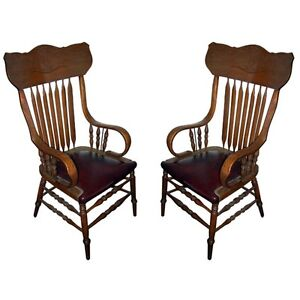 Pair of Oak Arrow-Back Arm Chairs with Burgundy Leather seats  c.1900 #8000