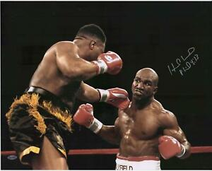 """Evander Holyfield Autographed 16"""" x 20"""" Punch vs. Ray Mercer Photograph"""