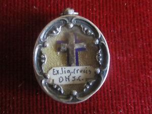 RELICARIO DE PLATA EX LIGNUM CRUCIS. D.N.J.C.