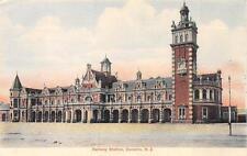 RAILWAY STATION DUNEDIN NEW ZEALAND TRAIN POSTCARD (c. 1908)