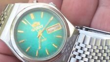 Orient Vintage Automatic Watch Crystal Tri Star Green Dial Off Center Dial .