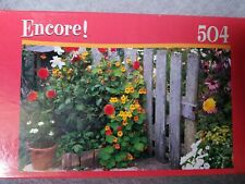 New sealed Mega Brand Encore! Neskowin, OR Puzzle 504 Pc. Flower garden fence