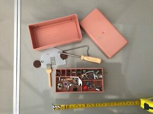 Vintage pink/peach colour box that holds sewing machine items