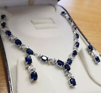 White gold finish oval blue sapphire and created diamond earrings and necklace