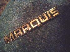 """- NOS Gold Mercury Marquis Emblem - Needs Double Sided Tape- 6 1/4"""" x 7/8"""""""