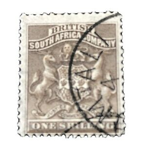 RHODESIA, SCOTT # 9, 1/. VALUE GRAY  BROWN 1891 COAT OF ARMS ISSUE USED