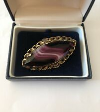 OUTSTANDING MIRACLE SIGNED LARGE SCOTTISH BROOCH WITH FACET-CUT GLASS SWIRL