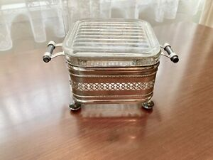 Antique Glass Bread Container in a Silver Container.