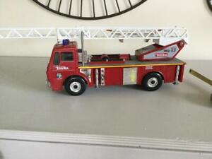 TONKA FIRE TRUCK WITH AERIAL LADDER /PLATFORM, SIRENS LIGHTS GOOD CONDITION.