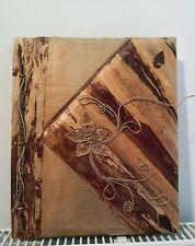 Fotoalbum mit getrocknete Blätter und Pflanzenteile