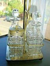 VINTAGE GLASS CONDIMENTS SET IN STAND